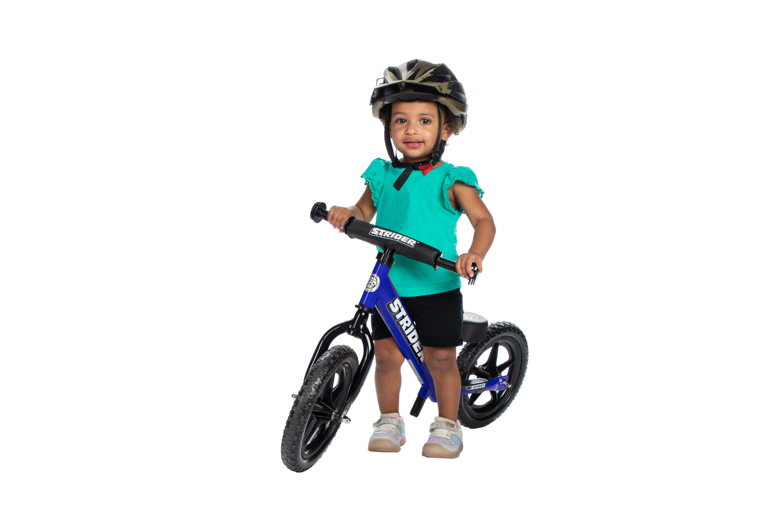 Young female on blue Strider 12 Sport