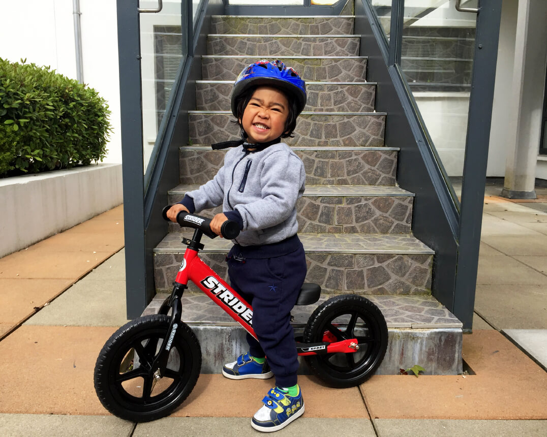 "Boy on Strider 12"" Balance Bike"