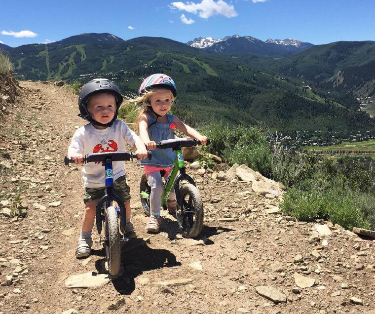 children riding Strider 12