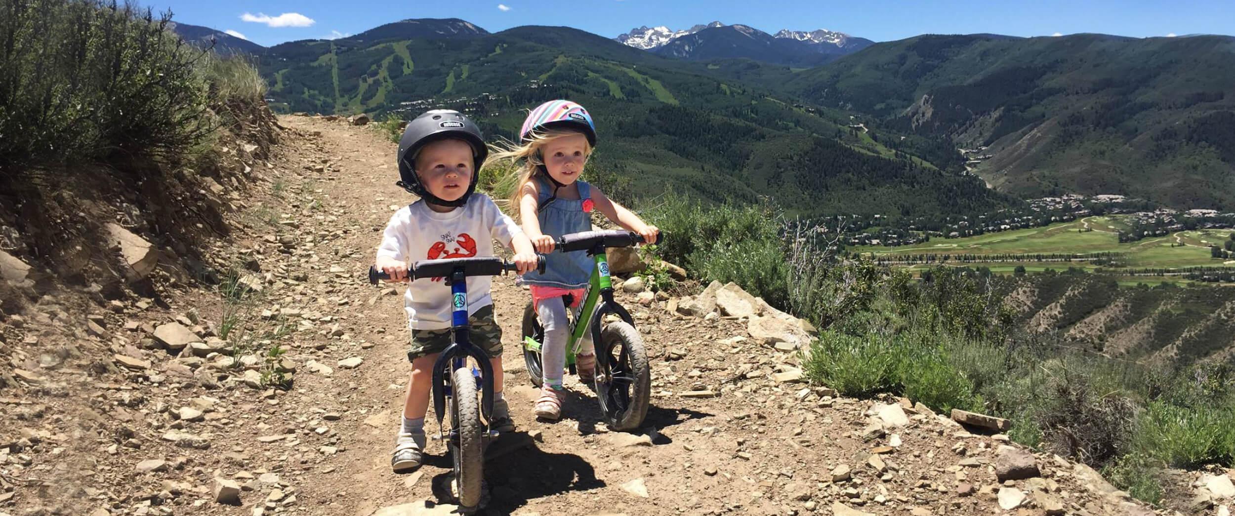 Kids riding Strider 12