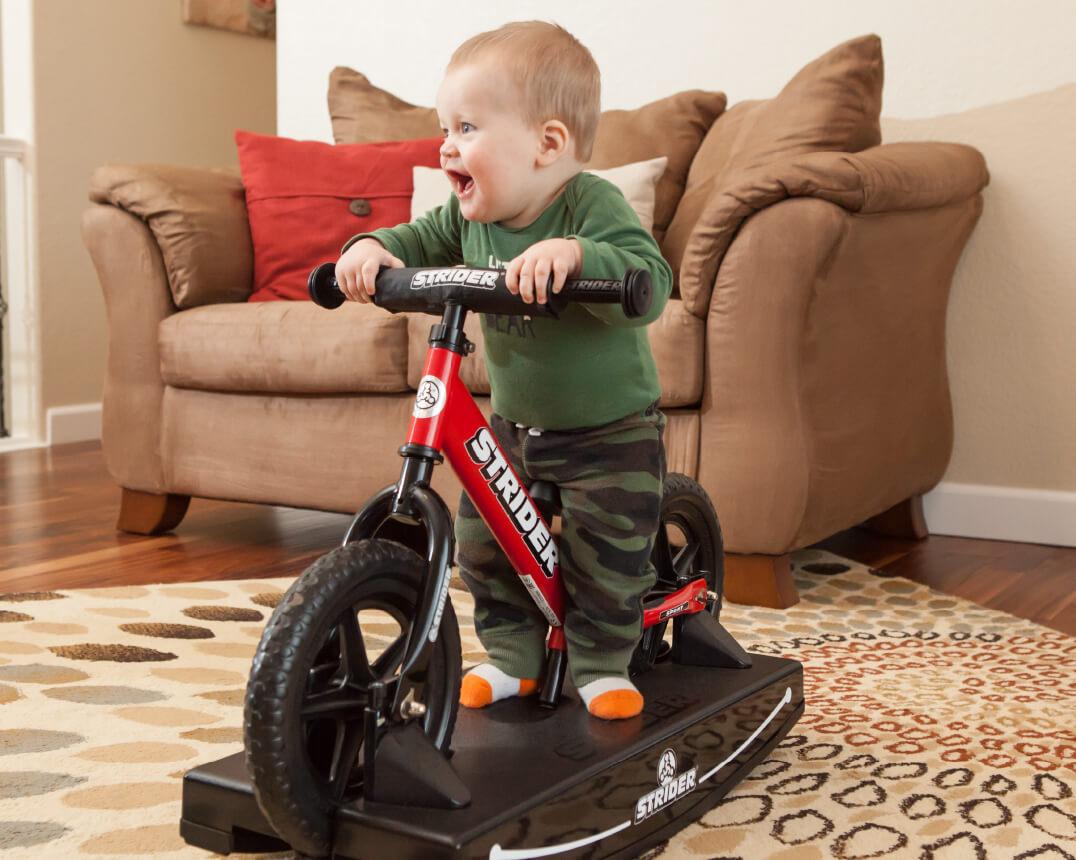 Baby on Strider Baby Bundle Balance Bike
