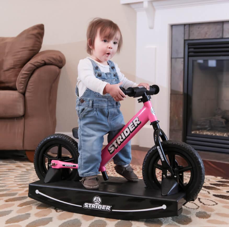 Baby girl on Strider Balance Bike