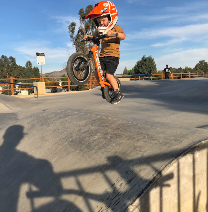 Boy on bike ramp with Strider Balance Bike