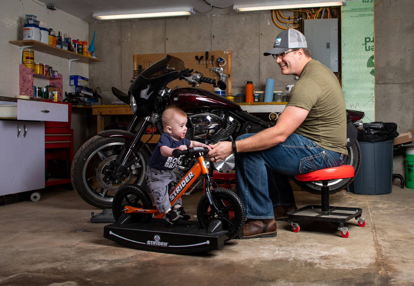 Dad with son on Strider Baby Bundle