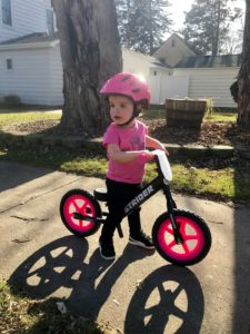 Girl on black sport with pink wheels