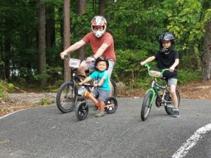 Family on Strider Balance Bikes