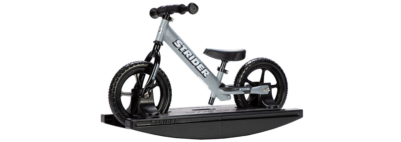 Studio image shot from a slight angle of the Strider 12 Sport 2-in-1 Rocking Bike in Matte Gray color