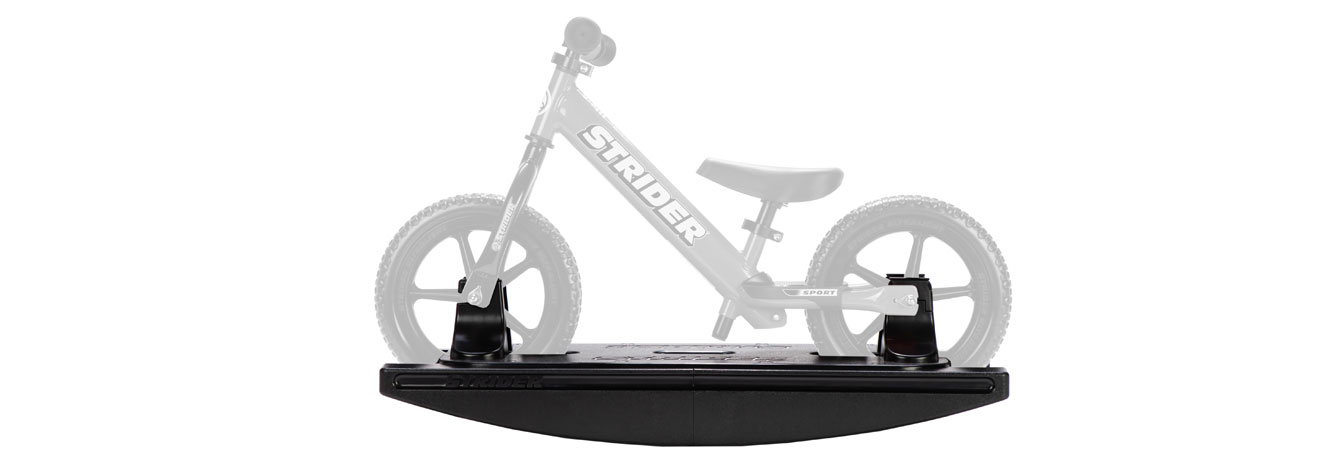 The Strider 2-in-1 Rocking Base with a grayed-out bike