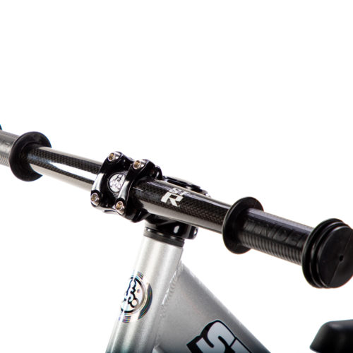 Studio image of silver 12 Pro with Strider ST-R Carbon Fiber Handlebar - close-up angled view