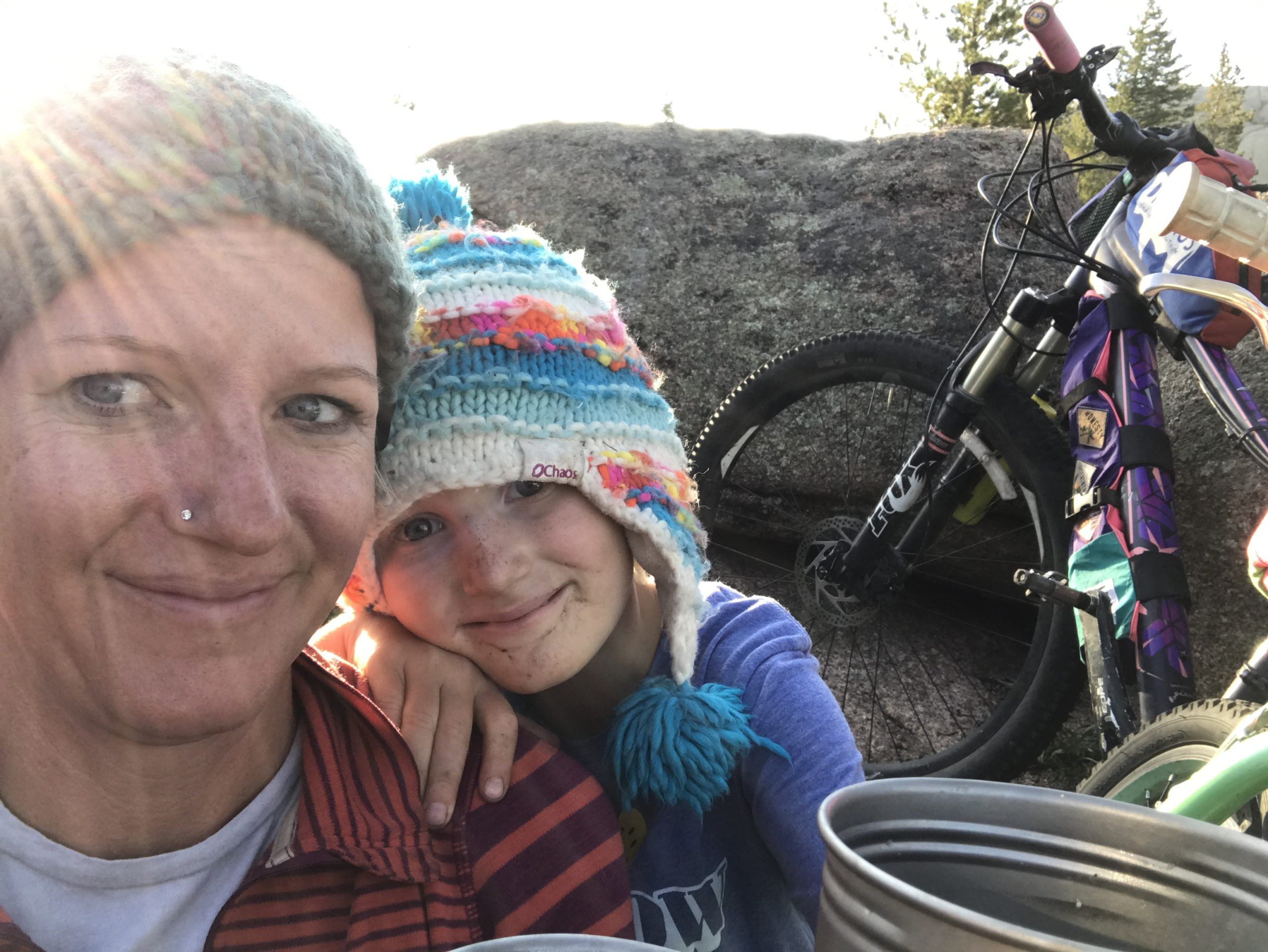 mother and daughter camping and biking