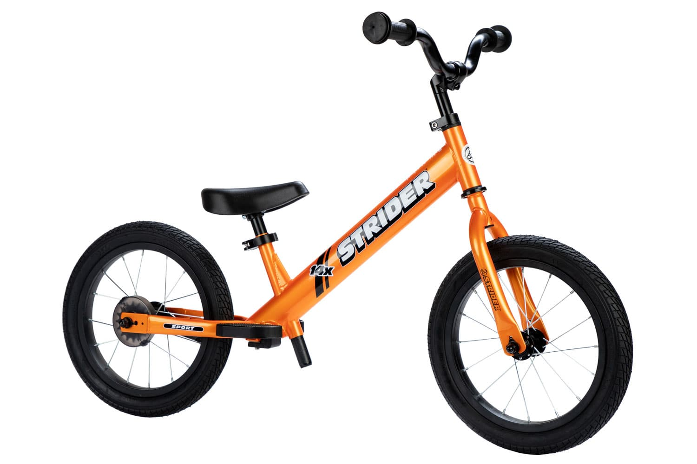 Studio view of Totally Tangerine Strider 14x Sport bike in balance mode